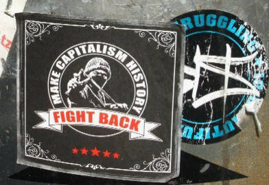 Make Capitalism History. Fight Back. Sticker in Zurich Switzerland. Plus BYS graffiti crew 10th anniversary sticker.