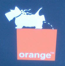 logo-busting in zurich switzerland. pissdog streetart sticker on top of orange telecom logo